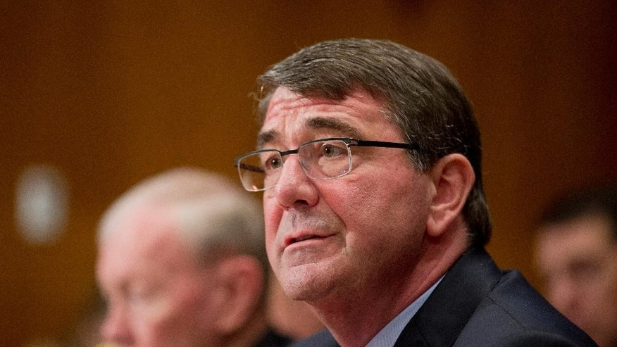 In this photo taken May 6, 2015, Defense Secretary Ash Carter, right, and Joint Chiefs Chairman Gen. Martin Dempsey testify on Capitol Hill in Washington. Carter is summoning top American defense and diplomatic leaders to Germany Friday to map out a counterstrategy to Russia's military operations in Ukraine and reassure allies worried about Moscow's aggression. (AP Photo/Manuel Balce Ceneta)
