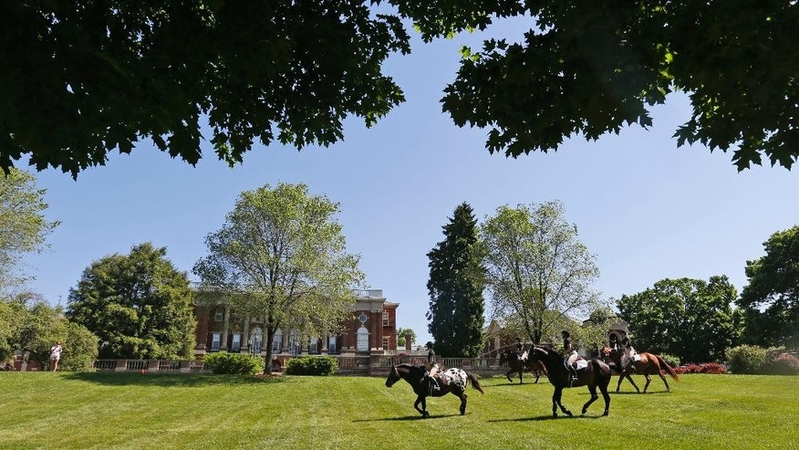 FILE This Wednesday May 13, 2015 file photo show graduating seniors at Sweet Briar college participate on the tradition Senior ride on the quad at the school in Sweet Briar, Va.   The senior ride is a tradition where seniors are allowed to ride horses on school grounds.  The Supreme Court of Virginia justices are scheduled to hear an appeal Thursday, June 4, 2015, of a failed bid to block the small college from shuttering its picturesque Blue Ridge Mountains campus in August.  (AP Photo/Steve Helber)