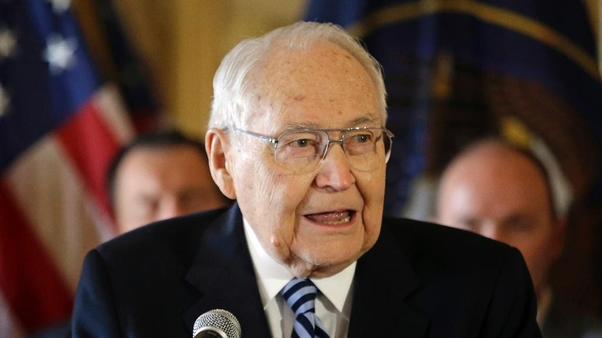 FILE - This March 4, 2015, file photo, L. Tom Perry, the second-most senior member of the high-level Mormon governing body called the Quorum of the Twelve Apostles, speaks during a news conference at the Utah State Capitol in Salt Lake City. Thousands are expected to attend a public funeral Friday, June 5, 2015, for Perry, who died at the age of 92 from cancer. (AP Photo/Rick Bowmer, File)