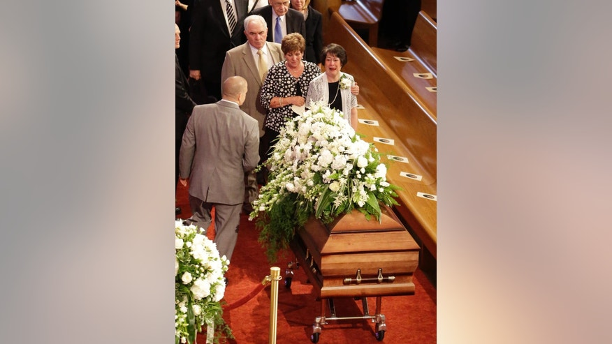 Mourners pay respects for L. Tom Perry, a member of The Church of Jesus Christ of Latter-day Saints' highest governing body, the Quorum of the Twelve Apostles,  at the Salt Lake Tabernacle during a attend a public funeral Friday, June 5, 2015, in Salt Lake City. Perry died at the age of 92 from cancer. (AP Photo/Rick Bowmer)