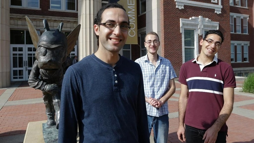 "Syrian brothers Molham Kayali, left, Ebrahim Kayali, right and Mohammad Kayali, back, pose for a photograph on the Emporia State University campus in Emporia, Kan., Wednesday, May 6, 2015.   Tens of thousands of college students in Syria have been displaced by the long-running conflict, creating an educational vacuum that colleges around the world are increasingly seeking to fill in the hopes that the ""academic refugees"" will someday help rebuild their country. Brothers, Molham, Mohammad and Ebrahim Kayali all landed at Emporia State University in Kansas and are emblematic of the plight and are among the 700 Syrian students in the U.S. (AP Photo/Orlin Wagner)"