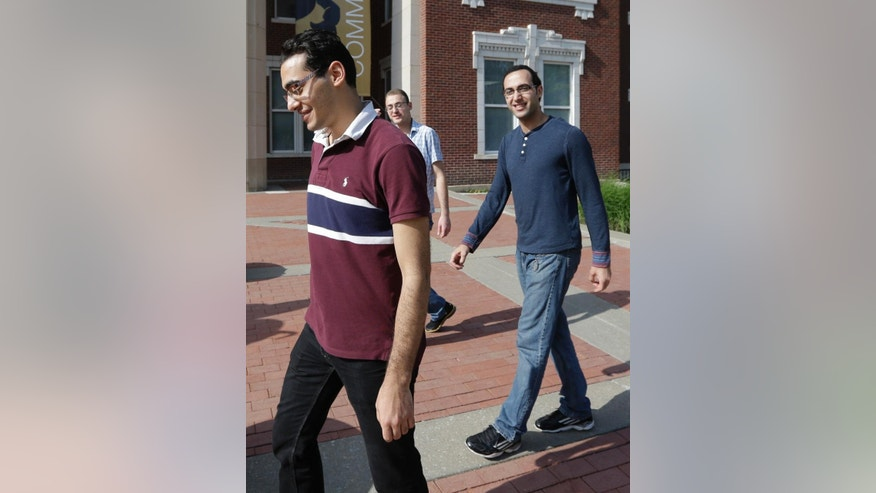 "Syrian brothers  Ebrahim Kayali, left, Molham Kayali, right and Mohammad Kayali, back, walk together on the Emporia State University campus in Emporia, Kan., Wednesday, May 6, 2015.   Tens of thousands of college students in Syria have been displaced by the long-running conflict, creating an educational vacuum that colleges around the world are increasingly seeking to fill in the hopes that the ""academic refugees"" will someday help rebuild their country. Brothers, Molham, Mohammad and Ebrahim Kayali all landed at Emporia State University in Kansas and are emblematic of the plight and are among the 700 Syrian students in the U.S. (AP Photo/Orlin Wagner)"