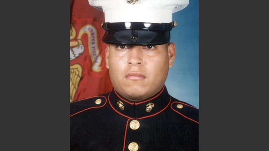 This file photo shows Sgt. Rafael Peralta. The Navy will posthumously award a Navy Cross to the Marine killed in Iraq, after years of appeals by his family asking the Pentagon to approve the Marine Corps' nomination for the Medal of Honor, the nation's highest award for military heroism. The family of Sgt. Peralta will accept the nation's second-highest award at a ceremony Monday, June 8, 2015, at Camp Pendleton, north of San Diego. (AP Photo/File)