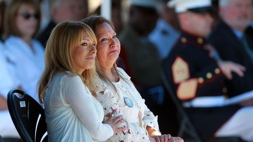 The family of Marine Sgt. Rafael Peralta received the Navy Cross from Navy Secretary Ray Mabus during a ceremony at Camp Pendleton, Calif., Monday, June 8, 2015. Peralta died during a firefight in Fallujah in 2004 and his family and others wanted him to be posthumously awarded the Medal of Honor for his actions. Icelda Donald, left, sister of Sgt. Rafael Peralta, and their mother Rosa Peralta, sit watching the posthumous Navy Cross ceremony at Camp Pendleton. (John Gastaldo/San Diego Union-Tribune via AP) NO SALES, NO ARCHIVING, TV OUT, MAGS OUT, TABLOIDS OUT, MANDATORY CREDIT