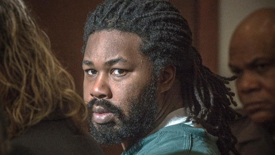 FILE - In this Nov. 14, 2014 file photo Jesse Matthew Jr. looks toward the gallery while appearing in court in Fairfax, Va. A woman who authorities say was sexually assaulted by the same man charged with killing a University of Virginia student came face to face with her alleged attacker in a Fairfax courtroom Thursday. The encounter was brief, and the woman's testimony was focused on a narrow legal question, though she did testify that his face looked familiar. But it provided a preview of the courtroom drama expected next week, when a jury trial begins for 33-year-old Jesse Matthew.   (AP Photo/The Washington Post, Bill O'Leary, Pool, File)