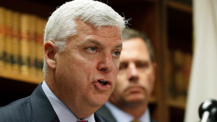 "Suffolk County District Attorney Daniel Conley speaks as FBI Special Agent in Charge Vincent Lisi listens during a press conference Monday, June 8, 2015, in Boston, after they released a surveillance video which they say shows the fatal shooting of a Boston man suspected of plotting to kill police officers. The video comes from a restaurant across the street, and the figures shown are blurry. Police and the FBI say it shows officers shooting 26-year-old Usaama Rahim on June 2 in the city's Roslindale neighborhood after they attempted to question him about ""terrorist-related information."" (AP Photo/Elise Amendola)"