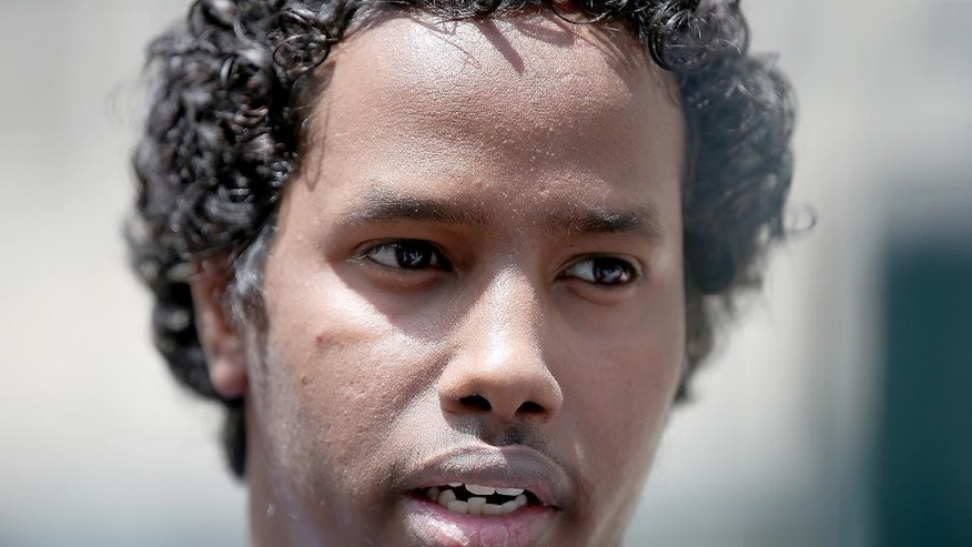 Mohamed Ali Omar speaks outside the federal courthouse, Tuesday, June 9, 2015, in Minneapolis. Omar, convicted of threatening FBI agents who were conducting a terror investigation, was released from custody Tuesday and his sentencing was postponed as a federal judge weighs whether a recent U.S. Supreme Court decision will affect the case. (Elizabeth Flores/Star Tribune via AP)