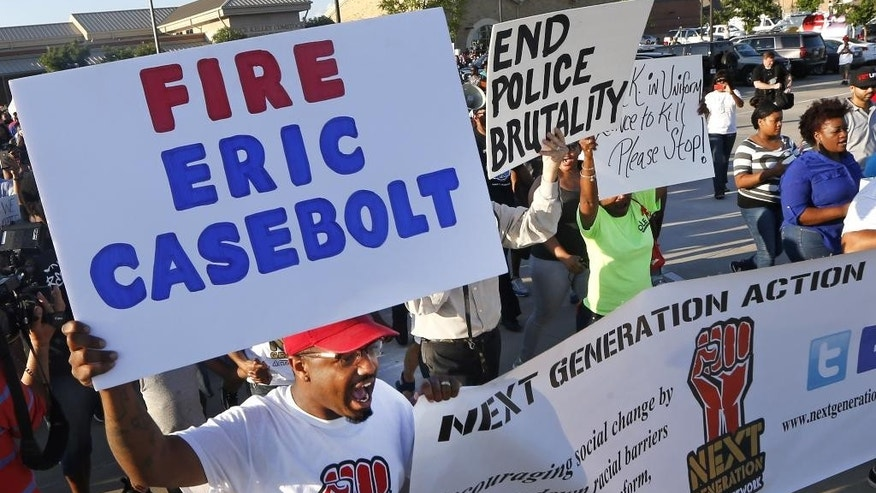 Protestors march Monday, June 8, 2015, during a demonstration  in response to an incident at a community pool involving McKinney police officers  in McKinney, Texas. (AP Photo/Ron Jenkins)
