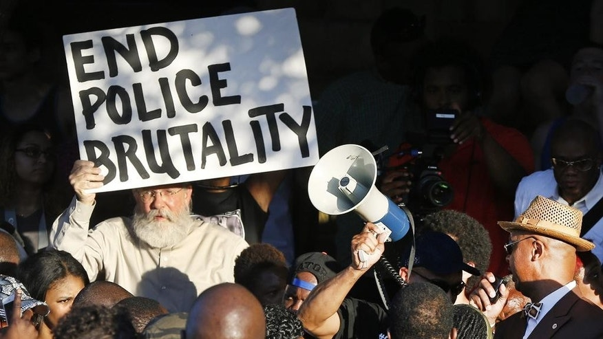 Demonstrators gather near a community pool during a protest Monday, June 8, 2015, in response to an incident at the pool involving McKinney police officers in McKinney, Texas. (AP Photo/Ron Jenkins)