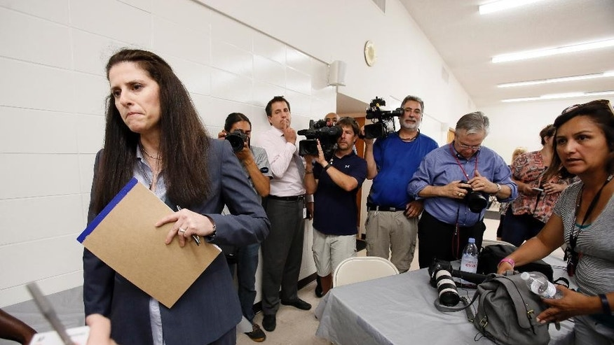 Jane Bishkin, the Dallas County Police Officer's Association attorney who represents former McKinney Officer David Eric Casebolt leaves a news conference, Wednesday, June 10, 2015, in Dallas. Casebolt is the white police officer who resigned after being caught on video pushing a black teenage girl to the ground outside a pool party. (AP Photo/Tony Gutierrez)