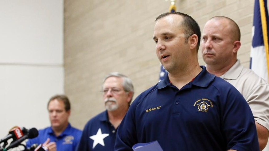 Daniel Malenfant, lodge president of the McKinney Fraternal Order of Police, leaves the podium during a news conference, Wednesday, June 10, 2015, in Dallas regarding former McKinney Officer David Eric Casebolt. Casebolt is the white police officer who resigned after being caught on video pushing a black teenage girl to the ground outside a pool party. (AP Photo/Tony Gutierrez)