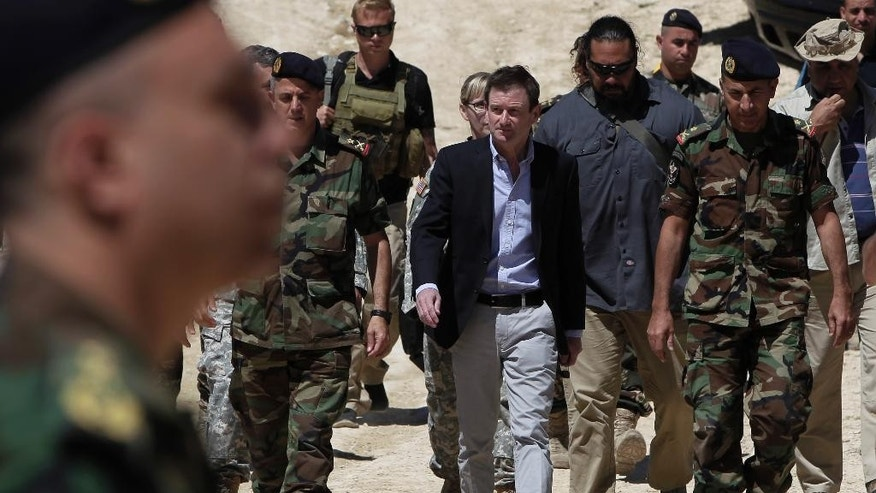 U.S. Ambassador to Lebanon David Hale, center, arrives in Taibeh village near the city of Baalbek, eastern Lebanon, Wednesday, June 10, 2015.  Hale is to attend a Lebanese army live-fire demonstration of advanced missiles it has received from the United States as part of American assistance to Lebanon as it fights Islamic extremists along its border with Syria. (AP Photo/Bilal Hussein)
