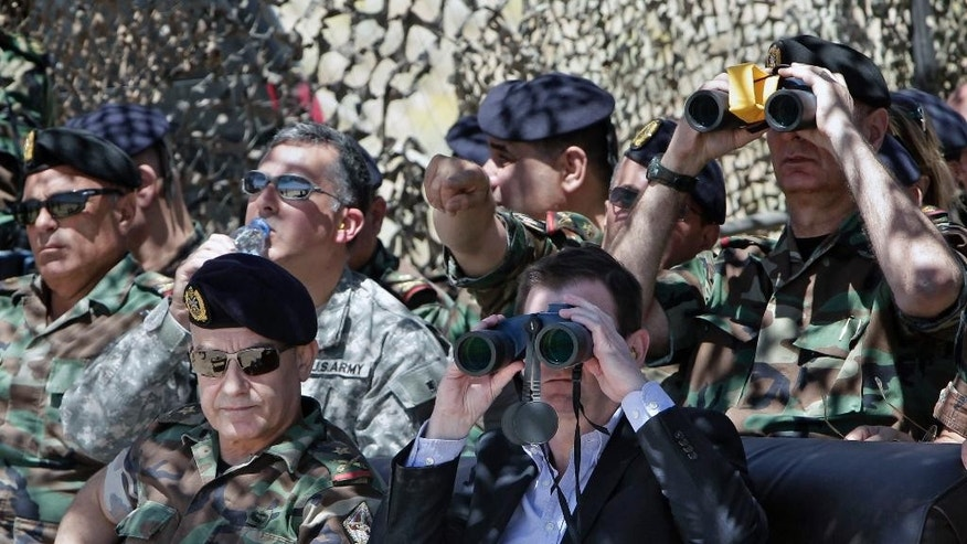 U.S. Ambassador to Lebanon David Hale, front right, looks through binoculars during a live-fire demonstration of advanced TOW-II missile, in the village of Taybeh, near Baalbek, eastern Lebanon, Wednesday, June 10, 2015. The Lebanese army has conducted a live-fire demonstration of advanced missiles supplied by the United States to help combat Islamic extremists along the country's volatile border with Syria. (AP Photo/Bilal Hussein)
