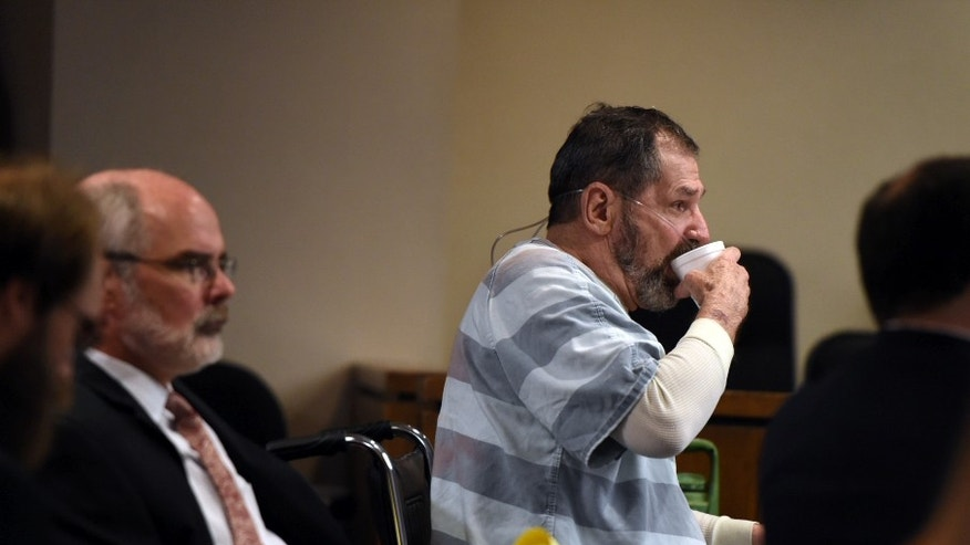 Frazier Glenn Miller Jr., also know as Frazier Glenn Cross, takes a drink of water while a 911 recording is played during a hearing Wednesday, June 10, 2015 in Olathe, Kan.  Miller Jr., 74,  is accused of killing three people on April 13, 2014 at two Jewish sites in the Kansas City suburb of Overland Park, Kansas.  (Shane Keyser/The Kansas City Star via AP)