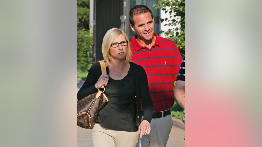 FILE - In this Monday, Aug. 4, 2014 file photo, Melissa Durham, left, and Kyle Durham, right, leave the Federal Courthouse in Oklahoma City, following a detention hearing for their son, Matthew Lane Durham. A Jury of eight men and four women, plus three alternate jurors, were seated after U.S. District Judge David Russell, prosecutors and defense attorneys asked about 70 prospective jury members questions, including whether they have been victims of sexual abuse. Matthew Lane Durham, 20, of Edmond, was a volunteer at the Upendo Children's Home in Nairobi, Kenya, and faces 17 counts of sexual misconduct including aggravated sexual abuse and engaging in illicit sexual conduct in foreign places. (AP Photo/Sue Ogrocki, File)
