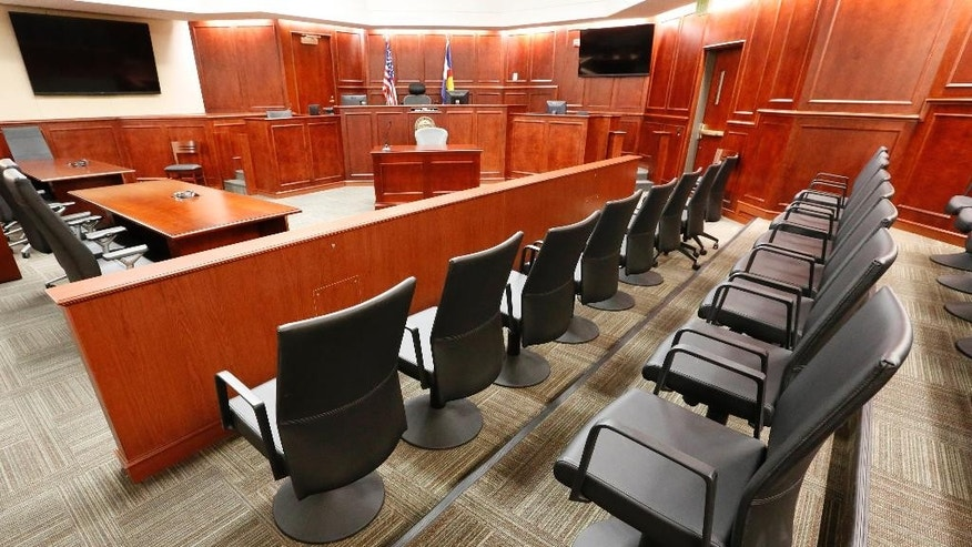FILE - This Jan. 15, 2015, file photo shows a view of the jury box, right, inside Courtroom 201, where jury selection in the trial of Aurora movie theater shootings defendant James Holmes was set to begin at the Arapahoe County District Court in Centennial, Colo. Three jurors in the Colorado theater shooting trial were dismissed Tuesday, June 9, 2015, amid concern they had been exposed to media coverage of the case and were discussing it among themselves. (AP Photo/Brennan Linsley, Pool, File)