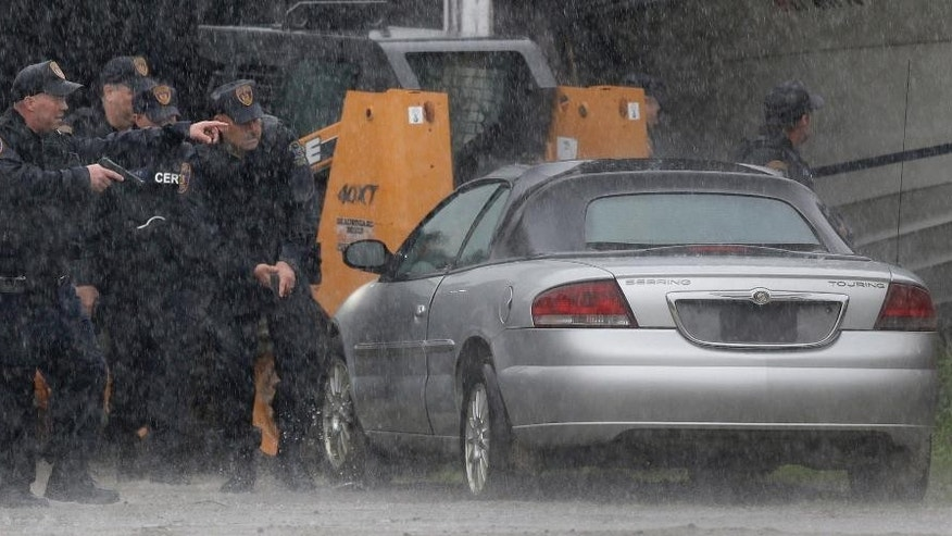 Law enforcement officers search for two escaped prisoners near Essex, N.Y., Tuesday, June 9, 2015. State and federal law officers searching for two killers who used power tools to break out of a maximum-security prison poured into the small town 30 miles away Tuesday after getting a report of a possible sighting. (AP Photo/Seth Wenig)