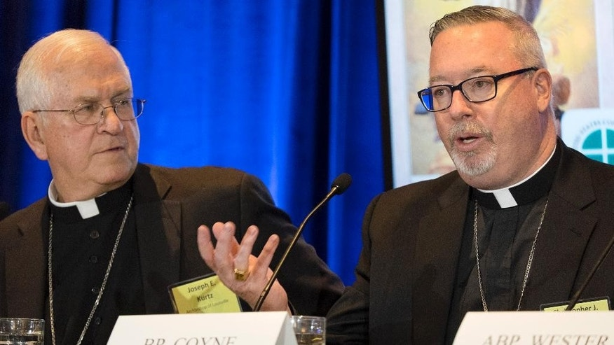 Bishop Christopher Coyne, right, of Burlington, and Archbishop Joseph Kurtz, of Louisville and president of the U.S. Conference of Catholic Bishops, participate in a news conference during the U.S. Conference of Catholic Bishops' Spring General Assembly in St. Louis Wednesday, June 10, 2015.  Roman Catholic bishops are condemning racism in the U.S. in light of national tensions over police treatment of African-Americans. (AP Photo/Sid Hastings)