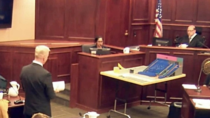 In this image made from video, Gargi Datta, a former girlfriend of Colorado theater shooter James Holmes, is questioned by District Attorney George Brauchcer, during a trail for Holmes, Thursday, June 11, 2015, in Centennial, Colo. Datta testified about online chats she had with Holmes in the months they dated. Holmes pleaded not guilty by reason of insanity in the July 2012 shooting at a suburban Denver movie theater that killed 12 people and injured 70. (Colorado Judicial Department via AP, Pool)
