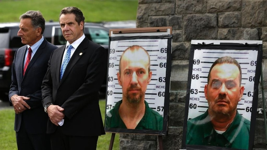 FILE - In this June 10, 2015 file photo, Vermont Governor Peter Shumlin, left, and New York Governor Andrew Cuomo listen during a news conference in front of the Clinton Correctional Facility in Dannemora, N.Y., where David Sweat and Richard Matt, escaped using power tools. As the hunt for the two escaped killers in New York stretches to almost a week, a review of past high-profile escapes shows most do in fact get caught sooner or later, tripped up by any number of missteps or miscalculations. (AP Photo/Seth Wenig, File)