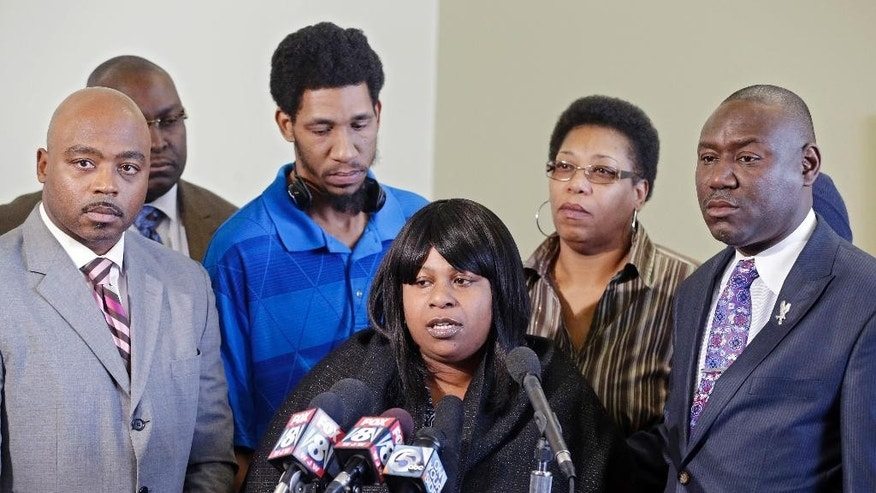 FILE - In this Jan. 6, 2015 file photo, Samaria Rice, center, speaks about the investigation into the death of her son Tamir Rice, at a news conference with attorneys Walter Madison, left, and Benjamin Crump in Cleveland. A judge has ruled that evidence exists to charge two police officers in the fatal shooting of a 12-year-old boy who was holding a pellet gun outside a recreation center, Thursday, June 11, 2015. (AP Photo/Mark Duncan, File)