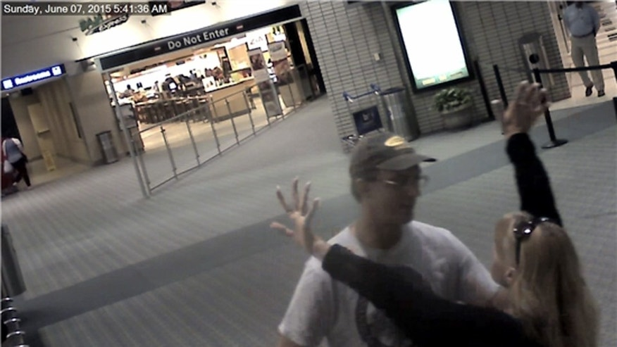 In this image taken from video made available by the Pinellas County Sheriff's Office, Charlie Enice Brooks greets Joseph Pope after Brooks arrived from Colorado at the Tampa International Airport in Tampa, Fla., Sunday, June 7, 2015. Brooks flew to Florida for a reunion with Pope — her teenage sweetheart — and was found murdered and floating in a canal on Monday, June 8. Pope later killed himself. (Pinellas County Sheriff's Office via AP)