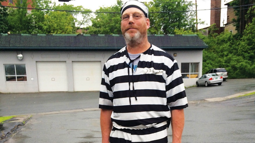 June 9 , 2015: James Lowe of Barnet, Vt., poses for a photo after a judge told him to leave the Caledonia County Courthouse in St. Johnsbury, Vt.