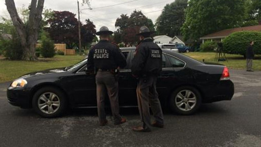 June 2, 2015: Rhode Island State Police check a car outside a home in Warwick, R.I. as part of an ongoing anti-terror investigation.(MyFoxBoston.com)