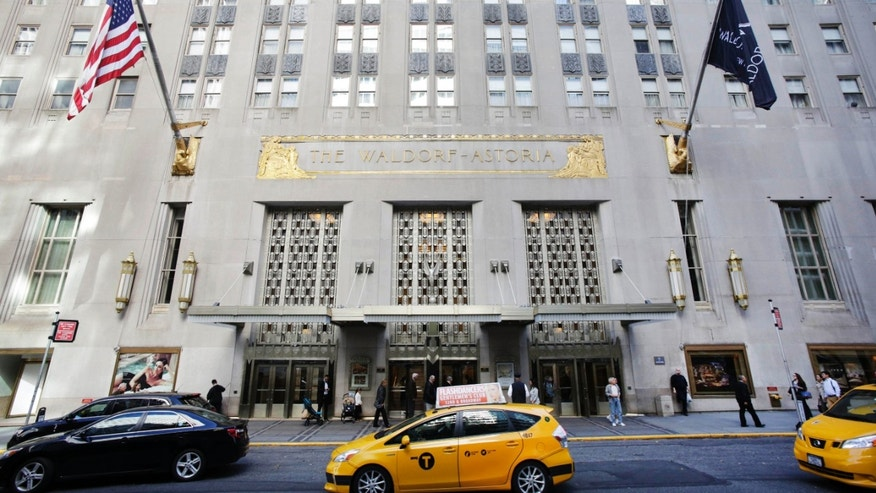 OCt. 6, 2014: A taxi passes in front of the fabled Waldorf Astoria hotel in New York.
