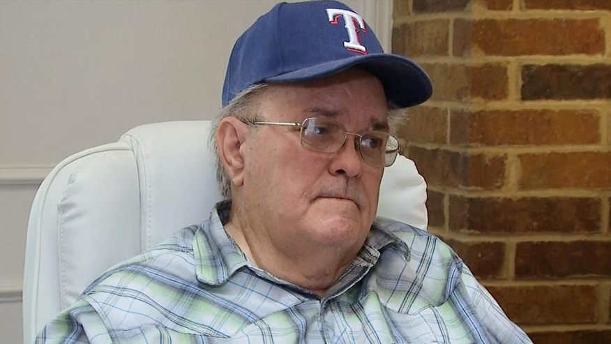 In this image from video, James Boulware speaks during an interview at his home in Carrollton, Texas, on Saturday, June 13, 2015. Boulware said he is the father of James Boulware, the name given to the police by the suspect who authorities say opened fire outside Dallas police headquarters from his parked van on Saturday. The gunman was the only person killed after the gunfire turned into a street battle and standoff. (AP Photo via AP Television)
