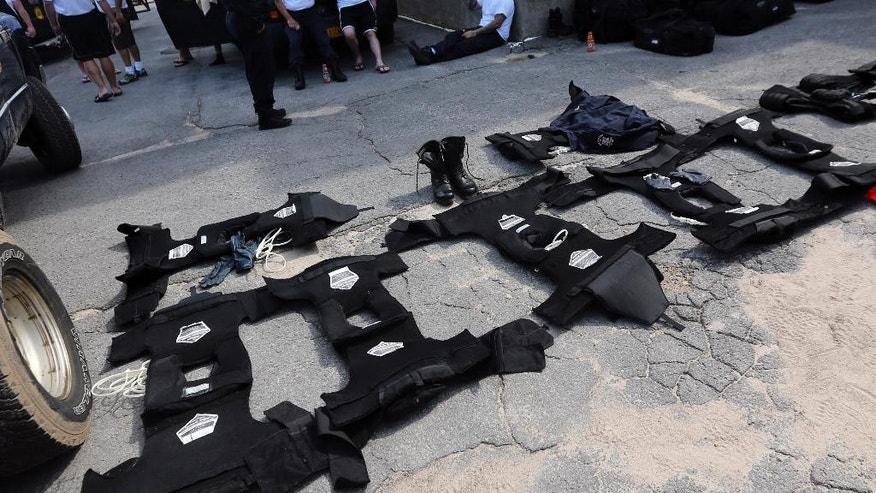 Gear used by corrections officers in the search for two escaped prisoners dries in a parking lot of a fitness facility Saturday, June 13, 2015, in Dannemora, N.Y. Authorities are in the eighth day of searching for David Sweat and Richard Matt, two killers who used power tools to cut their way out of Clinton Correctional Facility in northern New York. (AP Photo/Mike Groll)