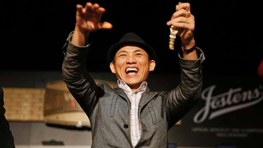 June 12, 2015: Christian Pham celebrates during a bracelet ceremony after he won the World Series of Poker No-Limit Deuce-to-Seven Lowball Draw tournament in Las Vegas.