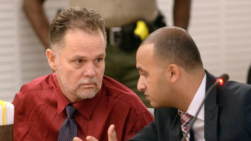 "FILE - In this May 22, 2015 file photo, Charles ""Chase"" Merritt, left, speaks to his attorney Jimmy Mettias during a hearing in San Bernardino Justice Center court in San Bernardino, Calif. Merritt, has a scheduled preliminary hearing Monday, June 15, 2015, on charges that he murdered his business partner, the man's wife and their two young sons. Prosecutors will contend that a Southern California man used a sledgehammer to kill the family of four before burying their bodies in shallow desert graves in 2013, but the defense will argue there isn't a shred of physical evidence tying him to the crime, a defense attorney said. (Will Lester/The Inland Valley Daily Bulletin via AP, Pool, File)"