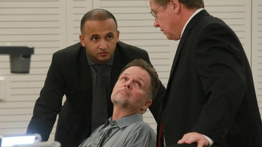 "Chase Merritt, center, speaks with his attorneys Jim Terrell, right, and Jimmy Mettias, left, before his preliminary hearing Monday, June, 15, 2015 in San Bernadino, Calif. Merritt is accused of killing four members of the McStay family in February 2010. A judge will decide whether Charles ""Chase"" Merritt, 58, must stand trial for the deaths of his business partner, Joseph McStay, the man's wife and their two young sons. (John Gibbins/U-T San Diego via AP, Pool)"