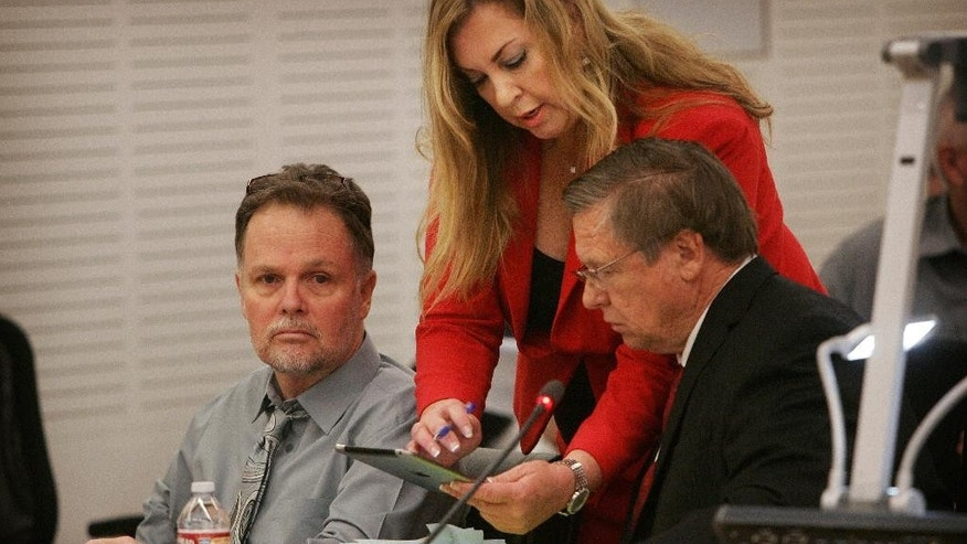 "Charles Merritt, left, sits in Department S-1 of the San Bernardino Justice Center, with defense attorneys Sharon Brunner and Jim Terrell before the start of his preliminary hearing on Monday, June 15, 2015, in San Bernardino, Calif. Merritt is accused of killing four members of the McStay family in February 2010. A judge will decide whether Charles ""Chase"" Merritt, 58, must stand trial for the deaths of his business partner, Joseph McStay, the man's wife and their two young sons. (Kurt Miller/The Press-Enterprise via AP, Pool)"