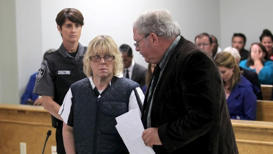 Joyce Mitchell stands with her lawyer Steven Johnston, appearing before Judge Buck Rogers in Plattsburgh City Court, New York, for a hearing Monday June 15, 2015. She is charged with helping Richard Matt and David Sweat escape from the Clinton Correctional Facility near the Canadian border on June 6. Mitchell, 51, was charged Friday with supplying hacksaw blades, chisels, a punch and a screwdriver. Her lawyer entered a not guilty plea on her behalf.  (G.N. Miller/NY Post via AP, Pool)