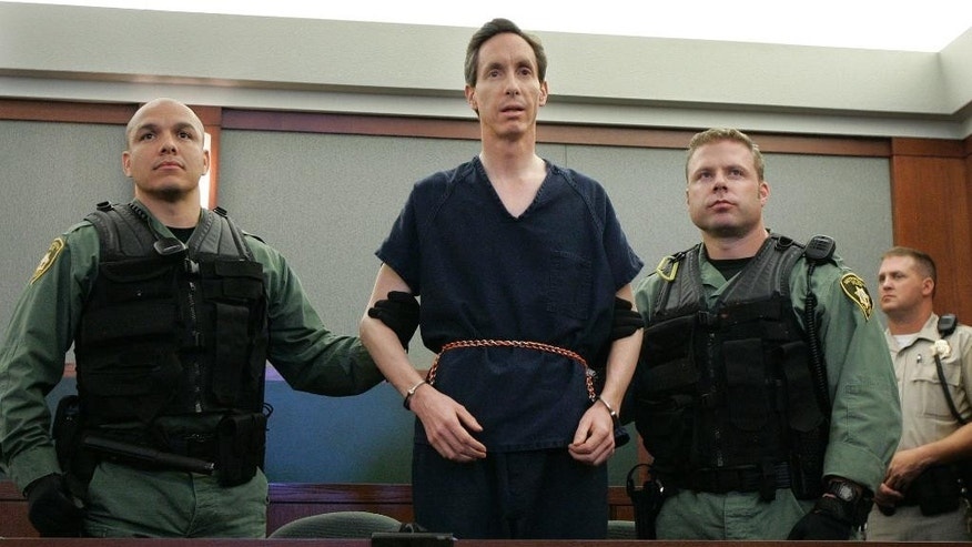 FILE - In this Aug. 31, 2006, file photo, polygamous church leader Warren Jeffs appears in a courtroom surrounded by guards, in Las Vegas. The red Cadillac Escalade used by Jeffs when he tried to flee authorities will be for sale in St. George. The Spectrum reports that the Escalade and the credit cards, gift cards and other items found inside it will be auctioned off. (AP Photo/Laura Rauch, File)