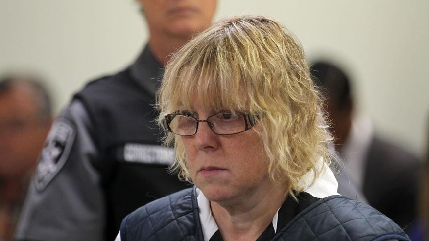 CORRECTS NAME OF JUDGE TO MARK ROGERS NOT BUCK ROGERS Joyce Mitchell appears before Judge Mark Rogers in Plattsburgh City Court, New York, for a hearing Monday, June 15, 2015. She is charged with helping Richard Matt and David Sweat escape from the Clinton Correctional Facility near the Canadian border on June 6. Mitchell, 51, was charged Friday with supplying hacksaw blades, chisels, a punch and a screwdriver. Her lawyer entered a not guilty plea on her behalf.  (G.N. Miller/NY Post via AP, Pool)