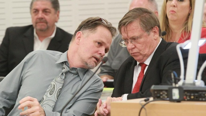 Chase Merritt speaks with his attorney Jim Terrell, right, Monday, June, 15, 2015 in San Bernadino, Calif. Merritt is accused of killing four members of the McStay family in February 2010. A judge will decide whether Merritt, 58, must stand trial for the deaths of his business partner, Joseph McStay, the man's wife and their two young sons. (John Gibbins/U-T San Diego via AP, Pool)