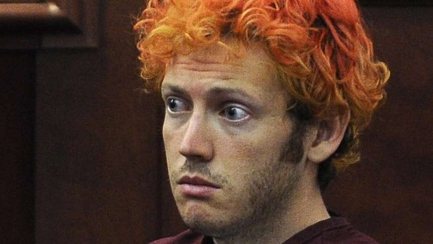 FILE - In this July 23, 2012, file photo, James Holmes, who is charged with killing 12 moviegoers and wounding 70 more in a shooting spree in a crowded theatre in 2012, sits in Arapahoe County District Court in Centennial, Colo. The person closest to the murderous thoughts of Holmes before he carried out his attack could take the witness stand the week of June 15, 2015, as the prosecution wraps up its case. Holmes' death penalty trial has revived unresolved questions about whether he could have been stopped. (RJ Sangosti/The Denver Post via AP, Pool, File)