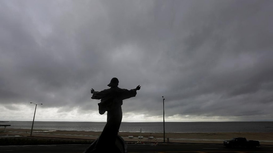 "A statue of Jesus calming the sea titled ""It is I"" faces the bay and gulf, in Corpus Christi, Tuesday, June 16, 2015, as Tropical Storm Bill begins to make landfall. The National Hurricane Center in Miami says Tropical Storm Bill came ashore Tuesday morning in the area of Matagorda County, about 90 miles southwest of Houston.  (AP Photo/Eric Gay)"