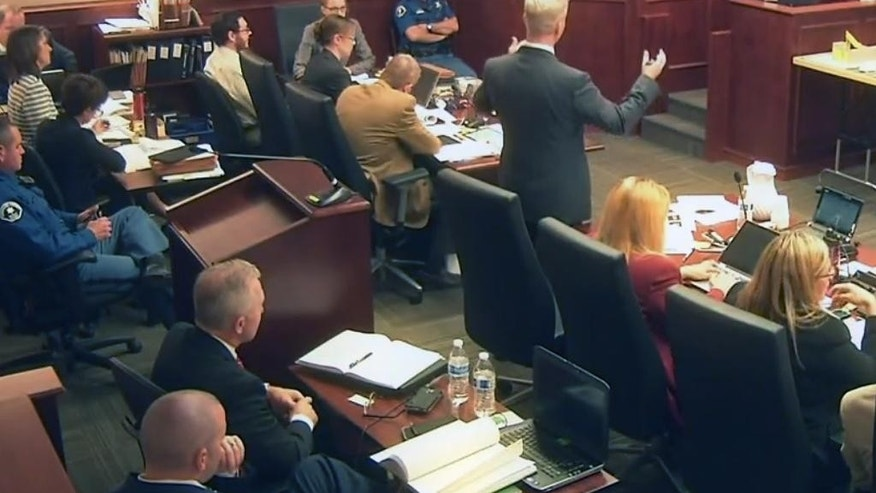 In this image taken from video, prosecutor George Brauchler, center top right, gestures as he questions  James Holmes' former psychiatrist Dr. Lynn Fenton, far right, who testified during a day of the trial of Holmes, pictured at top second from left in light-colored shirt and glasses, in Centennial, Colo., Tuesday, June 16, 2015. The psychiatrist who saw Holmes repeatedly before he carried out his deadly attack on a Colorado movie theater said Tuesday that she had been warned before their first meeting that he said he was thinking of killing people. (Colorado Judicial Department via AP, Pool)