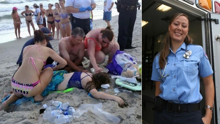 Marie Hildreth, right, a paramedic from Charlotte, is seen applying a makeshift tourniquet to the leg of 12-year-old shark attack victim Kiersten Yow, left.