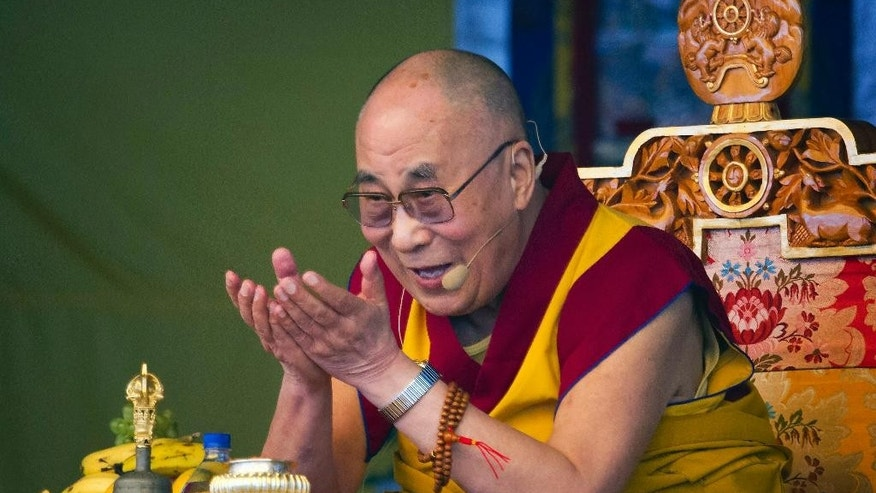 FILE - In a Friday, May 29, 2015 file photo, Tibetan spiritual leader the Dalai Lama gestures as he talks during a special ritual ceremony at the Tibetan Children's Village School in Dharmsala, India. The National Constitution Center CEO Jeffrey Rosen announced Wednesday, June 17, 2015 that the Dalai Lama will be honored with Philadelphia's Liberty Medal for his efforts to promote compassion and human rights around the globe.  (AP Photo/Ashwini Bhatia, File)