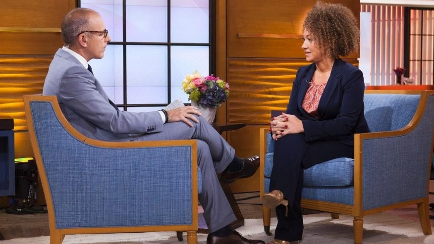 "In this image released by NBC News, former NAACP leader Rachel Dolezal appears on the ""Today"" show during an interview with co-host Matt Lauer, Tuesday, June 16, 2015, in New York. Dolezal, who resigned as head of a NAACP chapter after her parents said she is white, said Tuesday that she started identifying as black around age 5, when she drew self-portraits with a brown crayon, and ""takes exception"" to the contention that she tried to deceive people. Asked by Matt Lauer if she is an ""an African-American woman,"" Dolezal said: ""I identify as black."" (Anthony Quintano/NBC News via AP)"