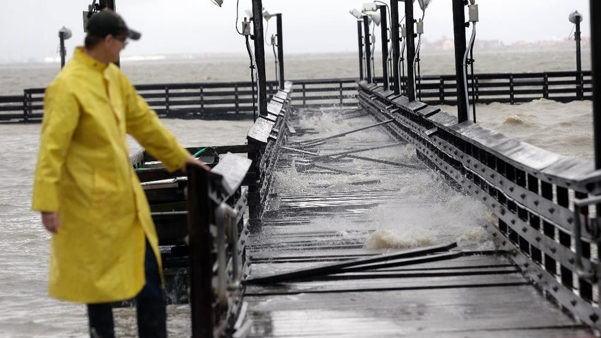 Port Lavaca Mayor Jack Whitlow surveys damage to a park pier as Tropical Storm Bill passes over, Tuesday, June 16, 2015, in Port Lavaca, Texas. The storm came ashore shortly before noon along Matagorda Island with maximum sustained winds of 60 mph, according to the National Hurricane Center in Miami. (AP Photo/Eric Gay)
