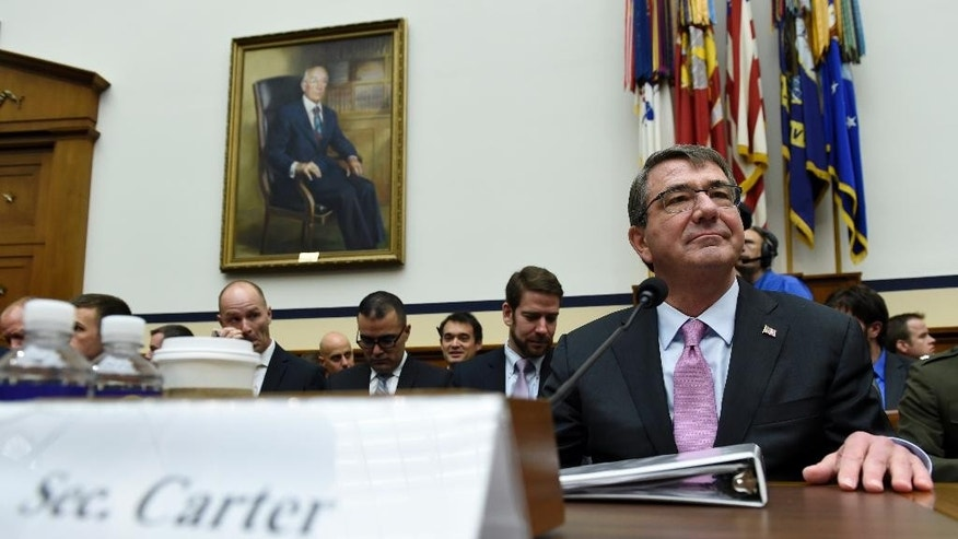Defense Secretary Ash Carter waits to testify on Capitol Hill in Washington, Wednesday, June 17, 2015, before the House Armed Services Committee hearing on the U.S. policy and strategy in the Middle East. (AP Photo/Susan Walsh)