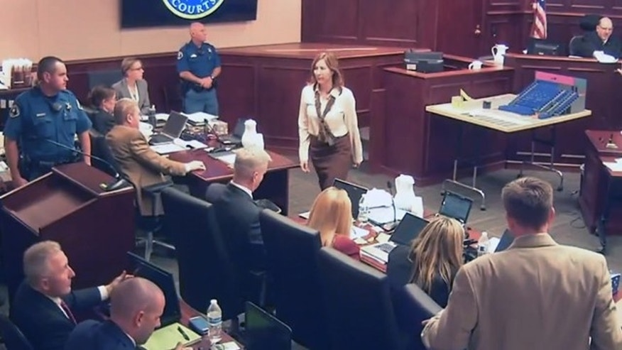 June 16, 2015: In this image taken from video, Colorado theater shooter James Holmes' former psychiatrist Dr. Lynne Fenton, center, exits the courtroom after testifying in the Holmes trial in Centennial, Colo. Dr. Fenton, who met with  Holmes therapeutically before he carried out his deadly attack on a Colorado movie theater said Tuesday that she had been warned before their first meeting that he said he was thinking of killing people. (Colorado Judicial Department via AP, Pool)