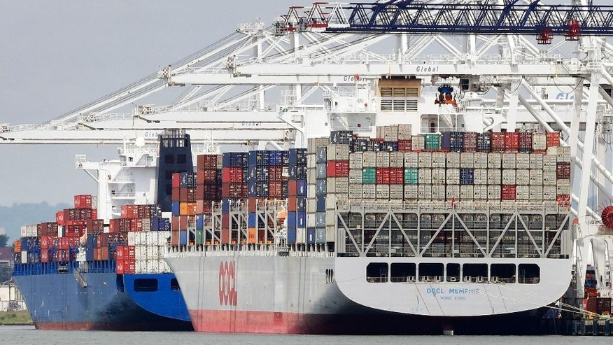 In this June 3, 2015, photo, container ships are docked at a shipyard, in Jersey City, N.J.  The Commerce Department reports on the U.S. current account trade deficit for the January-March quarter on Thursday, June 18, 2015. (AP Photo/Mark Lennihan)