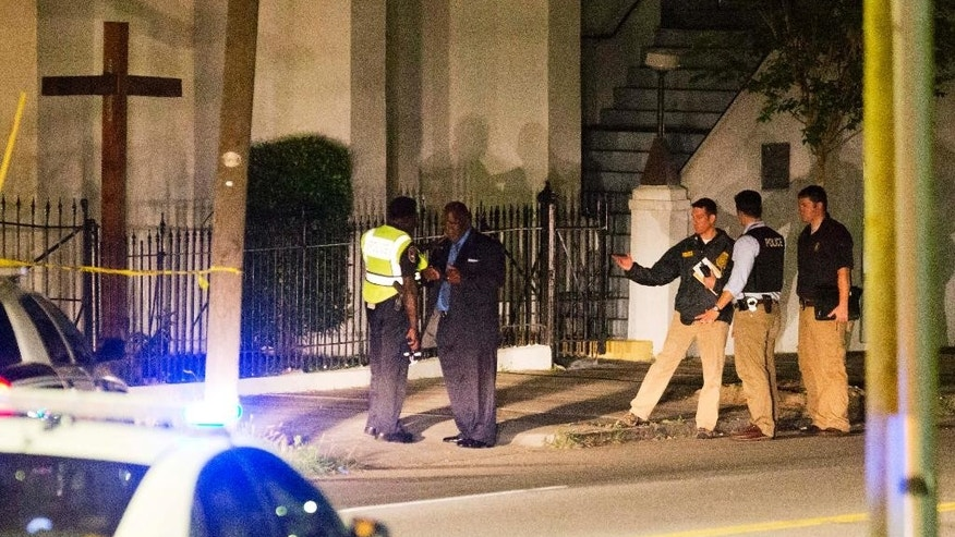 Police stand outside the Emanuel AME Church following a shooting Wednesday, June 17, 2015, in Charleston, S.C. (AP Photo/David Goldman)